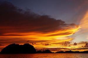 A Beautiful Sunset in Las Cabanas Beach in El Nido, Palawan