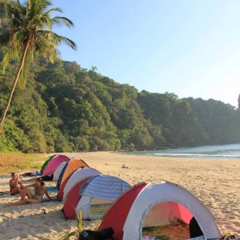 Setting camp on a beautiful beach for the overnight camping